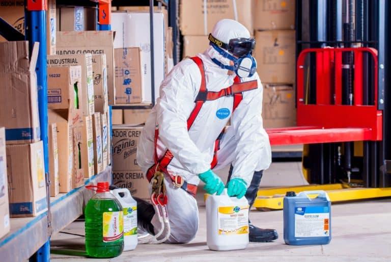 man-sanitizing-amazon-warehouse