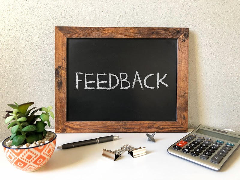 photo of a board with feedback written on it