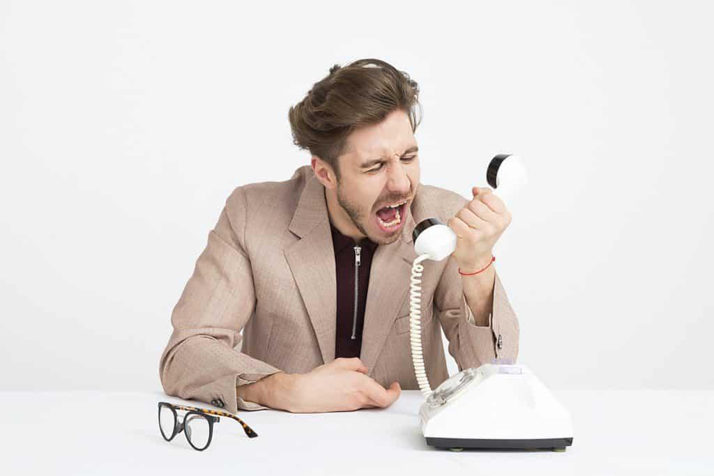 man-shouting-through-phone
