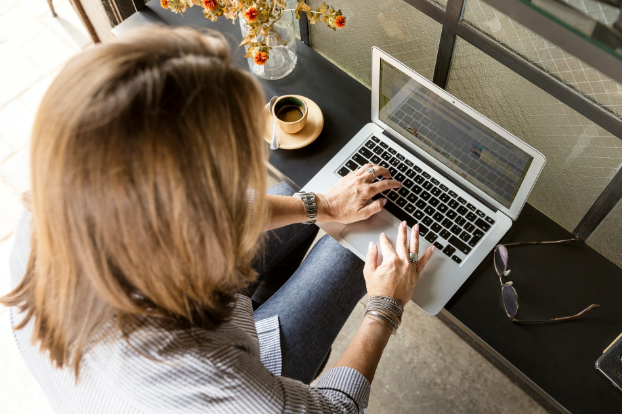 an image of lady using laptop