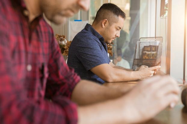 photo of men using gadgets