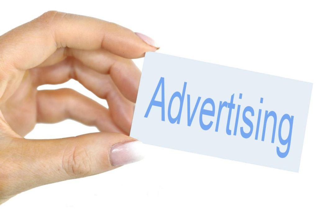 a-hand-holding-advertising-logo