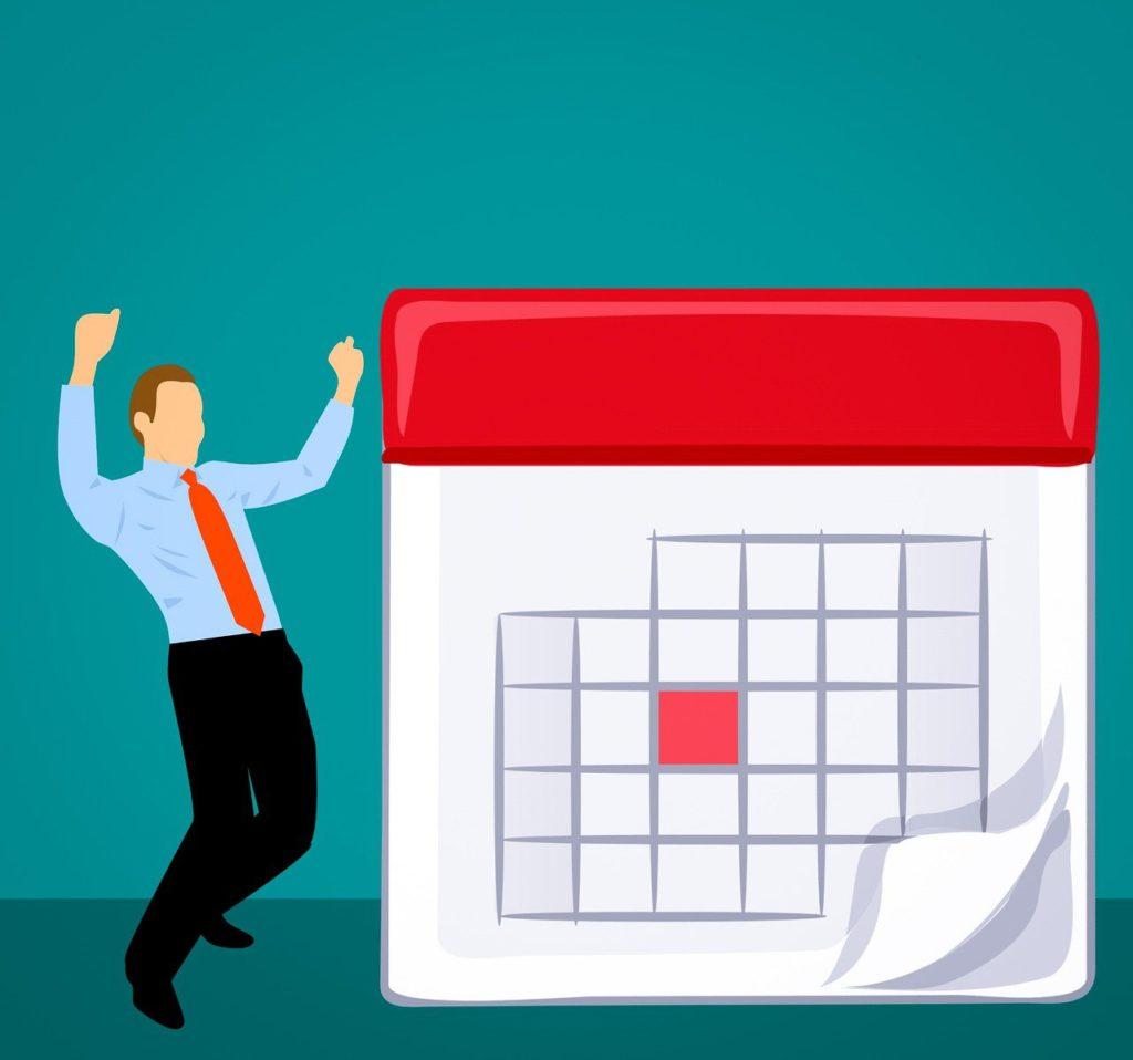 photo-of-man-in-front-calendar